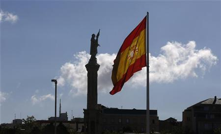 A Spanish flag flutters in the wind in central Madrid September 24, 2012. REUTERS/Andrea Comas