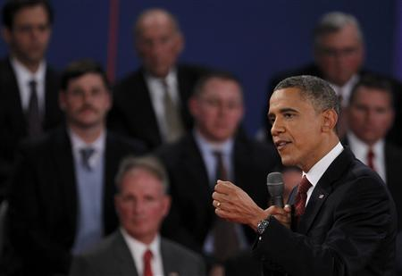 U.S. President Barack Obama (R) speaks as he debates Republican presidential nominee Mitt Romney during the second U.S. presidential debate in Hempstead, New York October 16, 2012. REUTERS/Lucas Jackson