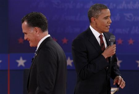 Republican presidential nominee Mitt Romney (L) listens to U.S. President Barack Obama during the second U.S. presidential campaign debate in Hempstead, New York, October 16, 2012. REUTERS/Jim Young