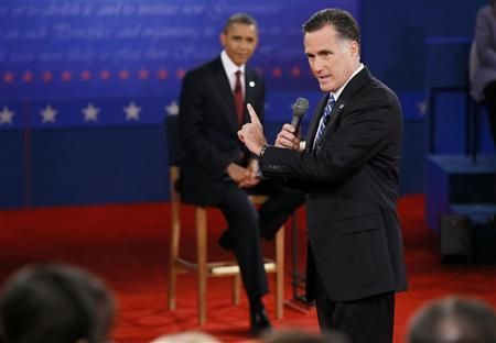U.S. President Barack Obama (L) listens as Republican presidential nominee Mitt Romney answers a question during the second presidential debate in Hempstead, New York, October 16, 2012. REUTERS/Rick Wilking