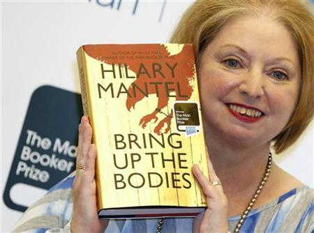 Author Hilary Mantel poses with her book 'Bring up the Bodies', after winning the 2012 Man Booker Prize, at the Guildhall in London October 16, 2012. Mantel wrote herself into the history books on Tuesday, becoming the first woman and first Briton to win the coveted Man Booker prize for fiction twice with 'Bring Up the Bodies', the sequel to her acclaimed 'Wolf Hall'. REUTERS/Luke MacGregor
