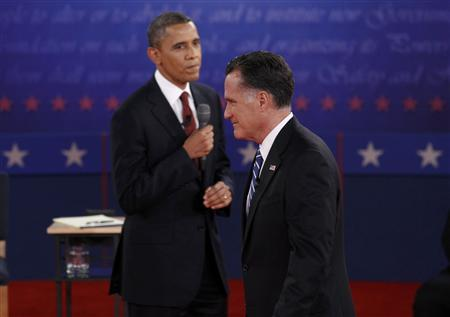 U.S. President Barack Obama (L) looks over at Republican presidential nominee Mitt Romney during the second U.S. presidential campaign debate in Hempstead, New York, October 16, 2012. REUTERS/Jim Young