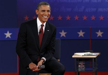 U.S. President Barack Obama listens during the second presidential debate with Republican presidential nominee Mitt Romney (Not Pictured) in Hempstead, New York, October 16, 2012. REUTERS/Jim Young