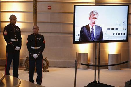 Two Marines watch a video during a public memorial service for slain U.S. Ambassador to Libya Christopher Stevens in San Francisco, California October 16, 2012. REUTERS/Stephen Lam