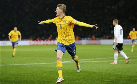 Sweden's Rasmus Elm celebrates after scoring a goal against Germany during the World Cup 2014 Group C qualifying soccer match in Berlin October 16, 2012. REUTERS/Fabrizio Bensch
