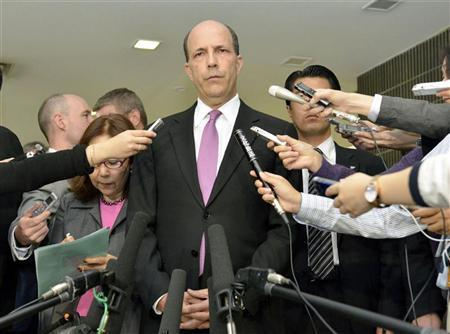U.S. Ambassador to Japan John Roos (C) delivers a statement after a meeting with Japan's Senior Vice Foreign Minister Shuji Kira (not in picture) at the Foreign Ministry in Tokyo, in this photo by Kyodo October 17, 2012. REUTERS/Kyodo