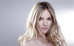 Actress Sienna Miller poses for a portrait at the London Hotel in New York October 5, 2012. REUTERS/Carlo Allegri
