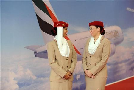 Emirates Airlines' flight attendants stand at the Emirates exhibition area during the World Route Development Strategy Summit at Abu Dhabi National Exhibition Centre, September 30, 2012. REUTERS/Ben Job