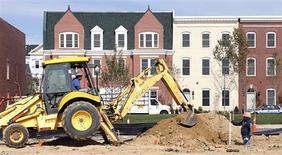 Workers prepare a new housing lot at a construction site in Alexandria, Virginia October 17, 2012. REUTERS/Kevin Lamarque