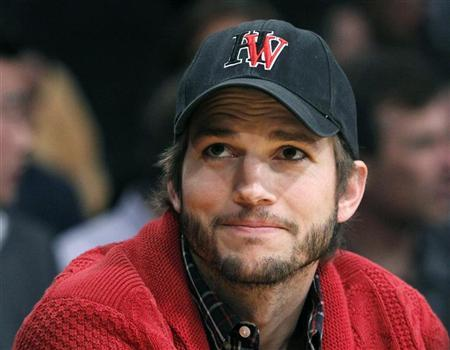 Actor Ashton Kutcher sits courtside during Game 2 of the Los Angeles Lakers against Denver Nuggets NBA Western Conference quarter-final basketball playoff game in Los Angeles, California May 1, 2012. REUTERS/Alex Gallardo