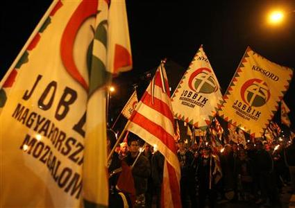 Supporters of the Hungarian far-right Jobbik party attend a demonstration in front of the infamous Avas apartment blocks during a demonstration in Miskolc, 180 km (112 miles) east of Budapest October 17, 2012. REUTERS/Laszlo Balogh