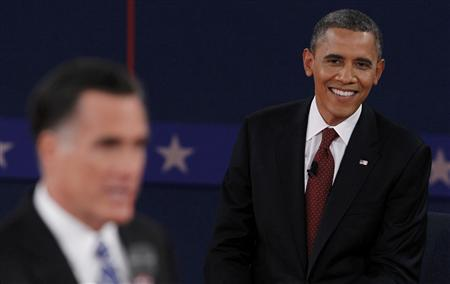 U.S. President Barack Obama (R) listens as Republican presidential nominee Mitt Romney (L) answers a question during the second presidential debate in Hempstead, New York, October 16, 2012. REUTERS/Lucas Jackson