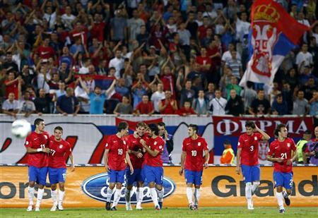 Serbia team players celebrate their fifth goal against Wales during their World Cup 2014 qualifying soccer match at the Karadorde Stadium in Novi Sad, September 11, 2012. REUTERS/Marko Djurica