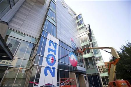 Workers work to put up a sign outside of Time Warner Cable arena, the venue for the Democratic National Convention, in Charlotte, North Carolina August 31, 2012. REUTERS/Chris Keane