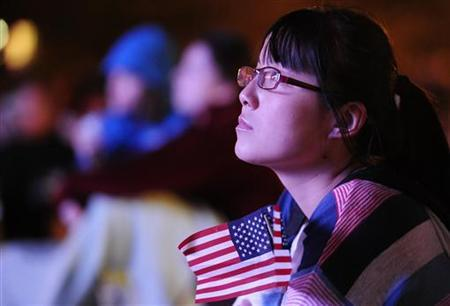 Kim Li, a junior at Denver University, watches the first 2012 U.S. presidential debate between U.S. President Barack Obama and Republican presidential nominee Mitt Romney on an outdoor screen at Denver University in Denver, Colorado October 3, 2012. REUTERS/Mark Leffingwell
