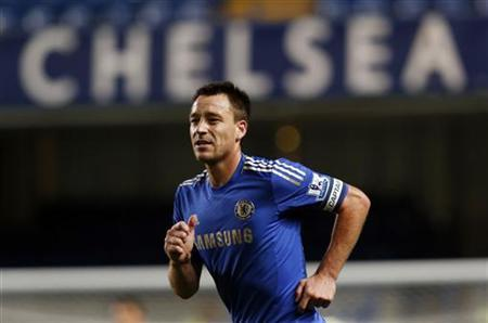 Chelsea captain John Terry runs during their English League Cup soccer match against Wolverhampton Wanderers at Stamford Bridge in London September 25, 2012. REUTERS/Eddie Keogh