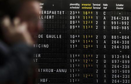 A departures screen indicates delayed flights in the main terminal of Frankfurt's airport, December 2, 2010. REUTERS/Alex Domanski