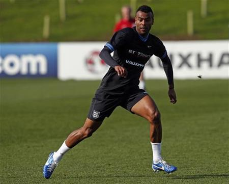 England's Ashley Cole attends a team training session at the official opening of St. George's Park, the Football Association's National Football Centre in Burton-Upon-Trent, central England October 9, 2012. REUTERS/Eddie Keogh