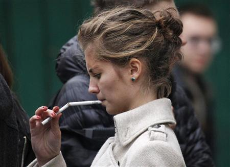 A student smokes on a street in Moscow October 16, 2012. REUTERS/Maxim Shemetov