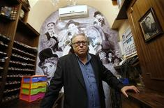 "Fernando Perez, 63, owner of the make-up store ""Harpo"", poses inside his business in Madrid October 4, 2012. REUTERS/Andrea Comas"