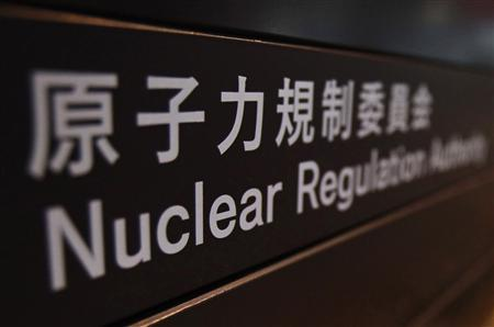 A sign is pictured at the lobby of the Nuclear Regulation Authority office building in Tokyo October 18, 2012. Japan's new nuclear regulator will impose tighter safety standards for atomic plants, taking account of geological data in the earthquake-prone country, its head said on Thursday. Shuichi Tanaka, in an interview, also said his new body would have the authority to restart reactors idled since last year's Fukushima disaster once new safety standards were in place and met. Restarting such units is a key point in reducing the import bill for fossil fuels to produce electricity. REUTERS/Yuriko Nakao