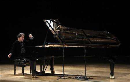 Turkish classical pianist Fazil Say performs during a concert in Ankara October 14, 2010. REUTERS/Stringer