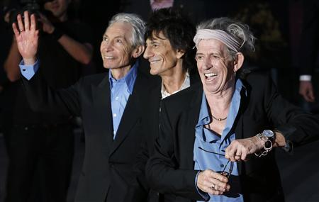 Rolling Stones members Keith Richards (R), Ronnie Wood (C) and Charlie Watts arrive for the world premiere of ''Crossfire Hurricane'' at the Odeon Leicester Square in London October 18, 2012. REUTERS/Suzanne Plunkett