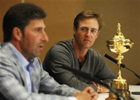 European Ryder Cup captain Jose Maria Olazabal (L) and Nicolas Colsaerts of Belgium speak during a news conference in a hotel near Heathrow Airport, in west London October 2, 2012. REUTERS/Luke MacGregor