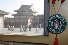 A Starbucks logo hangs inside its outlet inside the Forbidden City in Beijing January 18, 2007. REUTERS/Claro Cortes IV