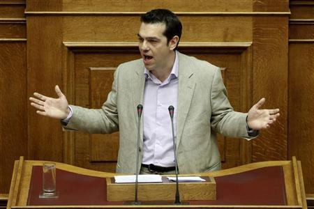 Head of opposition radical left SYRIZA party Alexis Tsipras addresses parliamentarians during a session at the parliament in Athens July 8, 2012. REUTERS/Yorgos Karahalis