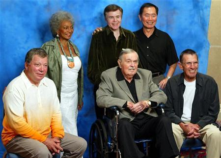 File photo of the cast of the original series of Star Trek William Shatner, Nichelle Nichols, Walter Koenig, George Takei, Leonard Nimoy (L-R) as they pose with James Doohan during a photo shoot at the convention as part of the ''Beam Me Up Scotty...One More Time, The James Doohan Farewell Star Trek convention & Tribute'' at the convention in Hollywood August 29, 2004. REUTERS/Gene Blevins
