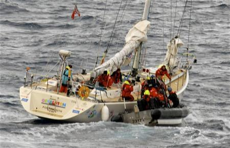 Crew from the Coast Guard Cutter Bertholf rescue two injured crew members from their stricken racing yacht off the California coast, in this U.S. Coast Guard handout photo made available to Reuters on April 1, 2012. REUTERS/U.S. Coast Guard/Handout