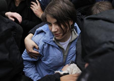 Yekaterina Samutsevich, a member of the female punk band ''Pussy Riot'', walks after she was freed from the courtroom in Moscow October 10, 2012. REUTERS/Maxim Shemetov