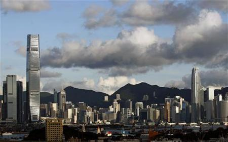 ICC (L) and IFC Two (R), the two highest commercial towers in Hong Kong, are seen at both sides of Victoria Harbour July 6, 2012. REUTERS/Bobby Yip