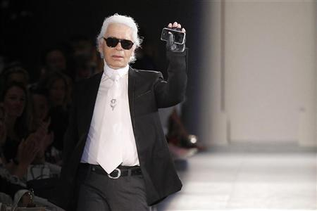 German designer Karl Lagerfeld appears at the end of his Haute Couture Fall-Winter 2012/2013 fashion show for French fashion house Chanel in Paris July 3, 2012. REUTERS/Benoit Tessier