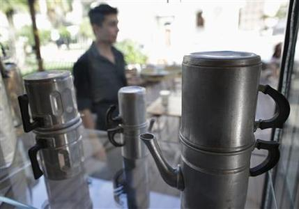 Old Moka machines are displayed in a cafe in downtown Rome October 19, 2012. As Europe's debt crisis drags on, more and more cash-strapped Italians are giving the coffee bar a miss and taking their morning caffeine hit in the kitchen. REUTERS/Tony Gentile