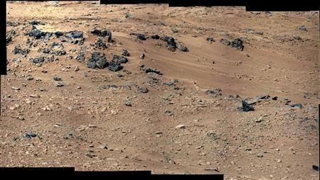 A patch of windblown sand and dust downhill from a cluster of dark rocks at the ''Rocknest'' site on Mars is shown in this September 28, 2012 NASA handout photo. REUTERS/ NASA/JPL-Caltech/MSSS