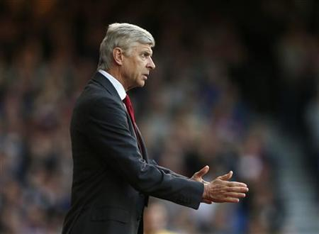 Arsenal manager Arsene Wenger reacts during their English Premier League soccer match against West Ham United at the Boleyn Ground in London October 6, 2012. REUTERS/Eddie Keogh