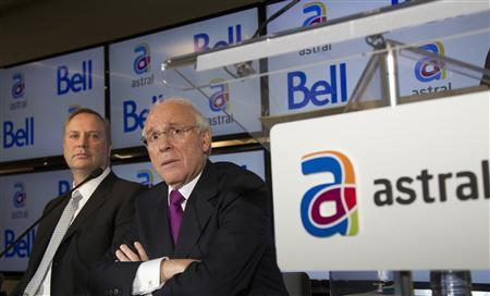 Bell Canada Enterprises (BCE) president and chief executive officer George Cope (L) and Ian Greenberg (R), president and chief executive officer of Astral Media Inc., speak at a news conference in Montreal in this March 16, 2012 file photo. Canada's broadcast regulator blocked BCE Inc's C$3 billion ($3.05 billion) takeover of Astral Media on October 18, declaring it would have given the Canadian media giant too much power. REUTERS/Christinne Muschi/Files