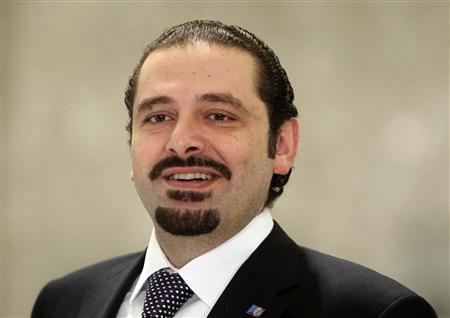 Lebanon's former caretaker Prime Minister Saad al-Hariri smiles after meeting with Lebanon's President Michel Suleiman at the presidential palace in Baabda, near Beirut, during the start of the two-day parliamentary consultations to choose a new prime minister, in this January 24, 2011 file photo. REUTERS/ Mohamed Azakir/Files