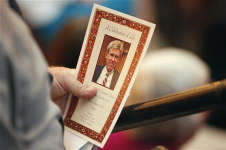 A mourner holds a program during a public memorial service for slain U.S. Ambassador to Libya Christopher Stevens in San Francisco, California October 16, 2012. REUTERS/Stephen Lam
