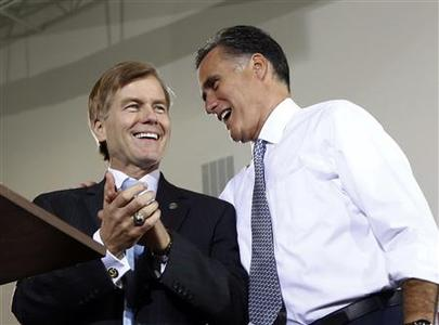 U.S. Republican presidential candidate Mitt Romney speaks to Virginia Governor Bob McDonnell (L) at an election rally in Sterling, Virginia, in this June 27, 2012 file photo. REUTERS/Jason Reed/Files