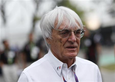 Formula One commercial supremo Bernie Ecclestone is pictured in the paddock ahead of the Singapore F1 Grand Prix at the Marina Bay street circuit in Singapore September 23, 2012. REUTERS/Edgar Su