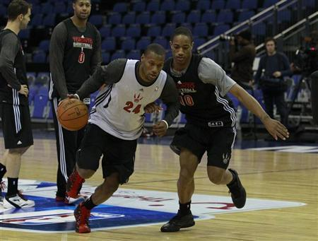 The Toronto Raptor's Sonny Weems and DeMar DeRozan participate in a basketball practice session ahead of their NBA game against the New Jersey Nets at the O2 Stadium in London March 3, 2011. REUTERS/Luke MacGregor