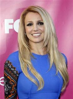 Judge Britney Spears poses at the season two premiere of the television series ''The X Factor'' at Grauman's Chinese theatre in Hollywood, California September 11, 2012. REUTERS/Mario Anzuoni