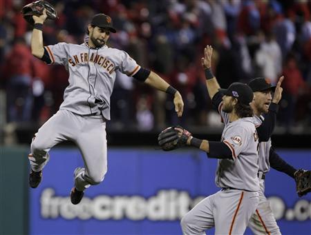 San Francisco Giants center fielder Angel Pagan celebrates with teammates Brandon Crawford and Hunter Pence (R) after their team defeated the St. Louis Cardinals in Game 5 of the MLB NLCS playoff baseball series in St. Louis, Missouri, October 19, 2012. REUTERS/John Gress