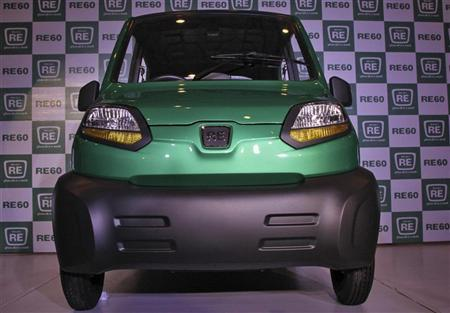 The newly launched Bajaj's first-ever four-wheeled vehicle RE60 is pictured in New Delhi January 3, 2012. REUTERS/B Mathur