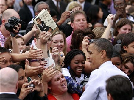 A copy of U.S. President Barack Obama's book ''The Audacity of Hope'' is held by a supporter looking for an autograph during a campaign rally at George Mason University in Fairfax, Virginia, October 19, 2012. REUTERS/Jason Reed