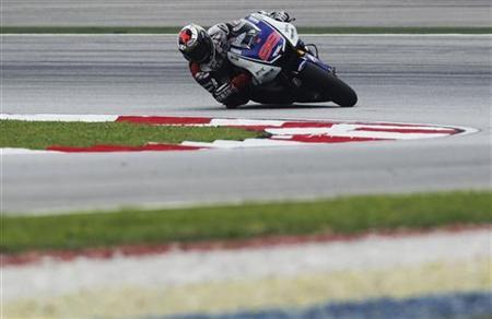 Yamaha MotoGP rider Jorge Lorenzo of Spain takes a corner during a free practice session ahead of the Malaysian Grand Prix in Sepang October 20, 2012. REUTERS/Stringer