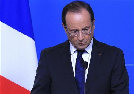 France's President Francois Hollande holds a news conference at the end of a European Union leaders summit in Brussels October 19, 2012. REUTERS/Yves Herman